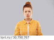 Купить «sad red haired teenage girl in shirt pouting», фото № 30790767, снято 28 февраля 2019 г. (c) Syda Productions / Фотобанк Лори