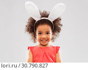 happy little girl wearing easter bunny ears. Стоковое фото, фотограф Syda Productions / Фотобанк Лори