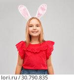 happy girl wearing easter bunny ears headband. Стоковое фото, фотограф Syda Productions / Фотобанк Лори