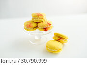 Купить «lemon yellow macarons on glass confectionery stand», фото № 30790999, снято 6 июля 2018 г. (c) Syda Productions / Фотобанк Лори