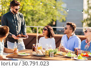 Купить «friends at bbq party on rooftop in summer», фото № 30791023, снято 2 сентября 2018 г. (c) Syda Productions / Фотобанк Лори