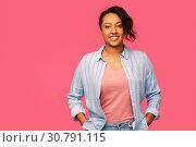 Купить «happy african american woman over pink background», фото № 30791115, снято 2 марта 2019 г. (c) Syda Productions / Фотобанк Лори