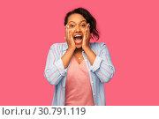 Купить «happy african american woman over pink background», фото № 30791119, снято 2 марта 2019 г. (c) Syda Productions / Фотобанк Лори