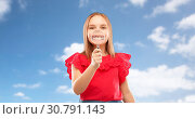 Купить «happy girl with magnifying glass over her teeth», фото № 30791143, снято 9 марта 2019 г. (c) Syda Productions / Фотобанк Лори