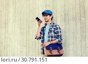 Купить «man using voice command or calling on smartphone», фото № 30791151, снято 15 июня 2016 г. (c) Syda Productions / Фотобанк Лори