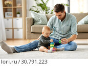 Купить «father playing with little baby daughter at home», фото № 30791223, снято 25 августа 2018 г. (c) Syda Productions / Фотобанк Лори