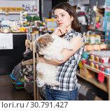 Купить «female with dog selecting vet preserves», фото № 30791427, снято 7 мая 2018 г. (c) Яков Филимонов / Фотобанк Лори