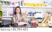 Купить «seller working with documents and goods in pet store», фото № 30791431, снято 7 мая 2018 г. (c) Яков Филимонов / Фотобанк Лори