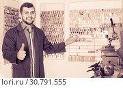 Купить «male worker showing his tools for making keys in workshop», фото № 30791555, снято 5 апреля 2017 г. (c) Яков Филимонов / Фотобанк Лори