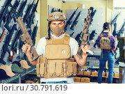 Купить «men in army uniform with gun in military market», фото № 30791619, снято 4 июля 2017 г. (c) Яков Филимонов / Фотобанк Лори
