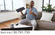 Купить «male blogger with keyboard videoblogging at home», видеоролик № 30791739, снято 26 апреля 2019 г. (c) Syda Productions / Фотобанк Лори