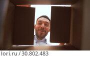 Купить «happy man opening parcel box», видеоролик № 30802483, снято 15 мая 2019 г. (c) Syda Productions / Фотобанк Лори