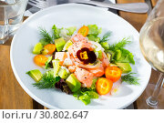 Купить «Ceviche from salmon with avocado, cumquat and green dill at plate with flower», фото № 30802647, снято 18 июня 2019 г. (c) Яков Филимонов / Фотобанк Лори
