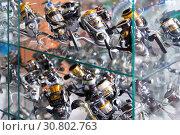 Image of stand with baitcasting reel for rod. Стоковое фото, фотограф Яков Филимонов / Фотобанк Лори