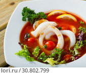 Купить «Spicy tomato soup with sea squids and greens served in a white bowl», фото № 30802799, снято 20 июня 2019 г. (c) Яков Филимонов / Фотобанк Лори