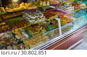 Купить «Assorted Turkish sweet-stuff on counter», фото № 30802851, снято 10 октября 2018 г. (c) Яков Филимонов / Фотобанк Лори