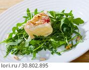 Купить «Camembert cheese with pine nuts and arugula», фото № 30802895, снято 14 июля 2020 г. (c) Яков Филимонов / Фотобанк Лори