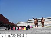 Купить «Pyongyang, North Korea. Bronze statue of Kim Il Sung and Kim Jong Il on the Mansu hill», фото № 30803211, снято 1 мая 2019 г. (c) Знаменский Олег / Фотобанк Лори