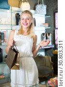 Купить «girl customer in bijouterie shop», фото № 30803311, снято 21 мая 2019 г. (c) Яков Филимонов / Фотобанк Лори