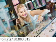 Купить «Portrait of young woman standing next to glass showcases», фото № 30803315, снято 21 мая 2019 г. (c) Яков Филимонов / Фотобанк Лори