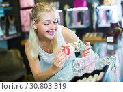 Купить «girl choosing bracelet in bijouterie shop», фото № 30803319, снято 21 мая 2019 г. (c) Яков Филимонов / Фотобанк Лори