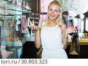 Купить «Smiling cheerful woman picking fashion earrings», фото № 30803323, снято 21 мая 2019 г. (c) Яков Филимонов / Фотобанк Лори