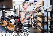 Купить «Happy female customer holding many pair of shoes», фото № 30803339, снято 26 мая 2019 г. (c) Яков Филимонов / Фотобанк Лори