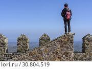 (Model Release) Woman watching the surrounding of Castelo de Vide village from the rooftop of the castle, Portalegre District, Alentejo Region, Portugal. Стоковое фото, фотограф Laurent Marolleau / age Fotostock / Фотобанк Лори