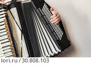 Купить «Accordionist with vintage accordion», фото № 30808103, снято 18 мая 2019 г. (c) EugeneSergeev / Фотобанк Лори