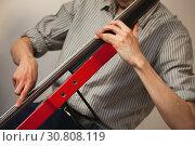 Купить «Hands of a man цшер electric contrabass», фото № 30808119, снято 18 мая 2019 г. (c) EugeneSergeev / Фотобанк Лори
