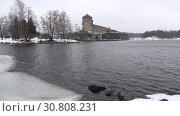 Купить «Вид на крепость Олавинлинна мартовским сумрачным днем. Савонлинна, Финляндия», видеоролик № 30808231, снято 16 марта 2019 г. (c) Виктор Карасев / Фотобанк Лори