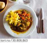 Купить «Image of baked pork cheeks in sauce with potatoes and vegetables», фото № 30808863, снято 16 июля 2019 г. (c) Яков Филимонов / Фотобанк Лори