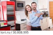 Happy couple in kitchen furniture salon. Стоковое фото, фотограф Яков Филимонов / Фотобанк Лори