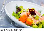 Купить «Tasty seafood ceviche from salmon with avocado, green dill and cumquat», фото № 30811047, снято 18 июня 2019 г. (c) Яков Филимонов / Фотобанк Лори