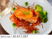 Купить «Deliciously steak of fried salmon with smoked carrots, broccoli and fig», фото № 30811087, снято 14 октября 2019 г. (c) Яков Филимонов / Фотобанк Лори