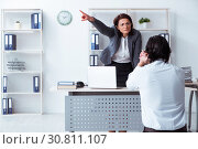 Купить «Old female boss and young male employee in the office», фото № 30811107, снято 11 февраля 2019 г. (c) Elnur / Фотобанк Лори
