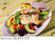 Купить «Tasty fried quail tobacco served with salad from avocado and greens», фото № 30811171, снято 15 июня 2019 г. (c) Яков Филимонов / Фотобанк Лори