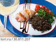 Купить «Stuffed squid with peppers, wild rice, eggs and herbs», фото № 30811207, снято 21 января 2020 г. (c) Яков Филимонов / Фотобанк Лори
