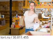 Купить «Girl is choosing light boxes», фото № 30811455, снято 19 апреля 2017 г. (c) Яков Филимонов / Фотобанк Лори