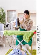 Купить «Woman in hijab doing clothing ironing at home», фото № 30811711, снято 10 декабря 2018 г. (c) Elnur / Фотобанк Лори