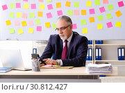 Купить «Aged man employee in conflicting priorities concept», фото № 30812427, снято 25 декабря 2018 г. (c) Elnur / Фотобанк Лори