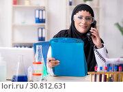 Купить «Female chemist in hijab working in the lab», фото № 30812631, снято 20 февраля 2019 г. (c) Elnur / Фотобанк Лори