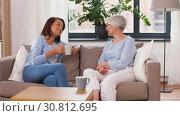 Купить «senior mother and daughter with coffee talking», видеоролик № 30812695, снято 12 мая 2019 г. (c) Syda Productions / Фотобанк Лори