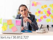 Купить «Young female employee in conflicting priorities concept», фото № 30812727, снято 19 декабря 2018 г. (c) Elnur / Фотобанк Лори