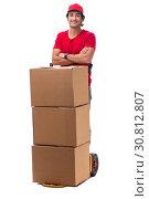 Купить «Young male courier with box», фото № 30812807, снято 9 ноября 2018 г. (c) Elnur / Фотобанк Лори