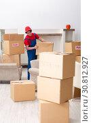 Купить «Young male contractor with boxes working indoors», фото № 30812927, снято 1 февраля 2019 г. (c) Elnur / Фотобанк Лори