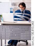 Купить «Young tied male employee in the office», фото № 30813343, снято 18 декабря 2018 г. (c) Elnur / Фотобанк Лори