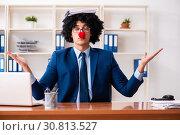 Купить «Young clown businessman working in the office», фото № 30813527, снято 14 декабря 2018 г. (c) Elnur / Фотобанк Лори