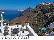 The terrace view café, the Caldera and the Aegean sea. Fira, Santorini, Greece (2017 год). Стоковое фото, фотограф Наталья Волкова / Фотобанк Лори
