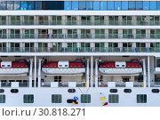 Купить «Multiple deck of Cruise Liner Norwegian Jewel with lifeboats aboard ship», фото № 30818271, снято 10 мая 2019 г. (c) А. А. Пирагис / Фотобанк Лори